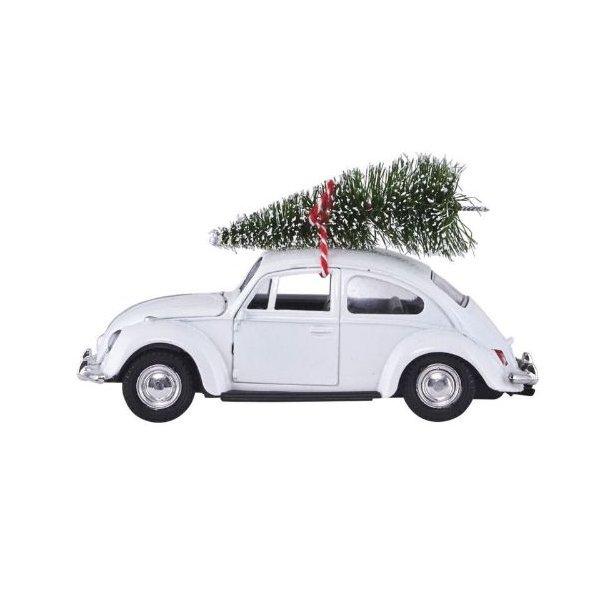 Bil med juletre på taket